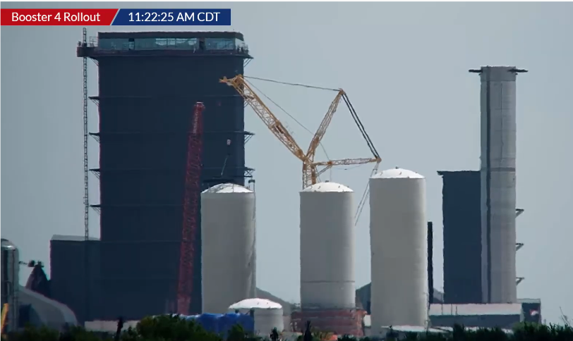 Screenshot 2021-08-03 at 18-22-44 LIVE Super Heavy Booster 4 rolls to pad with 29 Raptor engines - YouTube.png